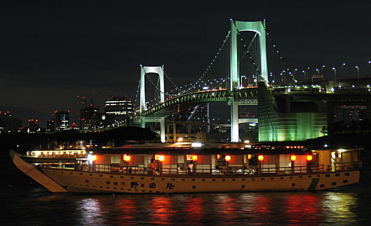 Yakatabune at night in front of Rainbow Bridges